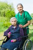 Senior woman with caregvier Stock Images