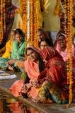 Senior women perform puja - ritual ceremony at holy Pushkar Sarovar lake,India. PUSHKAR, INDIA - NOVEMBER 12:Unidentified senior women perform puja - ritual royalty free stock images