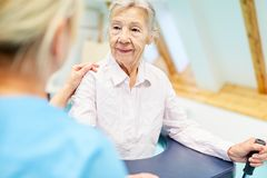 Senior woman is learning to walk in physiotherapy royalty free stock photos
