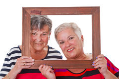 Senior women with picture frame Stock Photography