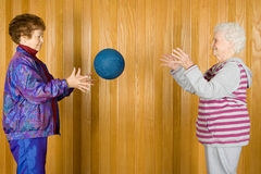 Senior women playing catch Royalty Free Stock Images