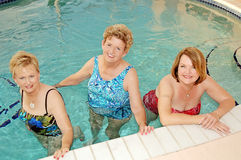 Senior women in the pool. Three smiling senior women in the swimming pool stock photo