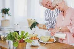 Senior woman preparing breakfast Royalty Free Stock Photos