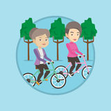 Senior women riding on bicycles in the park Stock Images