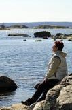 Senior women on a Scandinavian sea coast. Outdoor portrait of senior women admiring sea coast view Royalty Free Stock Photography