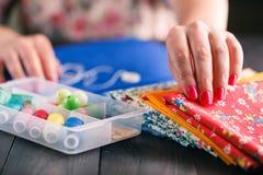 Senior women sews by hand Stock Photo