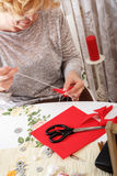 Senior women sews by hand Stock Photography