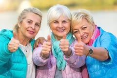 Senior women showing thumbs up Stock Photos