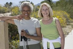 Senior Women Stand With Walking Poles Stock Photos