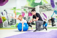 Senior woman is stretching with ball. Senior women is stretching with ball in gym Stock Photography