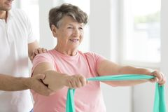 Senior woman during individual rehabilitation stock photography