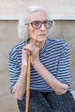 Senior women supporting on a walking cane Royalty Free Stock Images