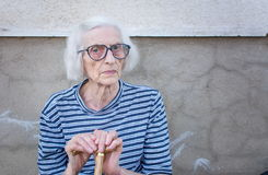 Senior women supporting on a walking cane Stock Images