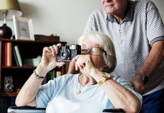 Senior woman taking a picture royalty free stock photography