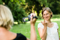 Senior mother is taking video of her child stock image