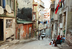 Senior women talking near the poor street houses in area Tarlabasi, Istanbul Stock Images