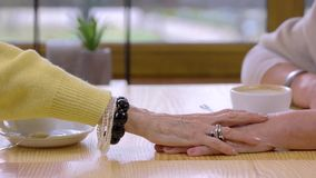 Senior women touching hands. stock footage