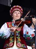 Senior women in traditional ukrainian clothes  pla Royalty Free Stock Photography