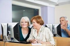 Senior Women Using Computer In Classroom Stock Photos