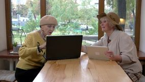 Senior women using laptop. stock video footage
