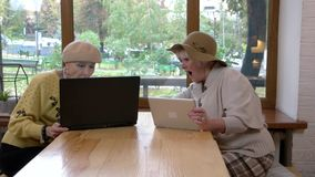 Senior women using a laptop. stock footage