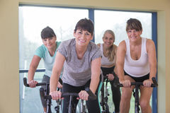 Senior women using spinning bikes Royalty Free Stock Images
