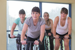 Senior women using spinning bikes Stock Photography