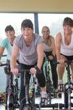 Senior women using spinning bikes Royalty Free Stock Photos