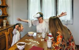 Senior woman using virtual reality glasses. Senior women using virtual reality glasses with her daughter and granddaughter Royalty Free Stock Images