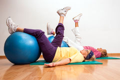 Senior women working out with fitness balls. Stock Photo