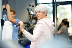 Senior woman working out in gym stock photography