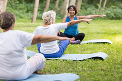 Senior women working out in a park with trainer Royalty Free Stock Image