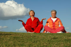 Senior women yoga outdoors Stock Image