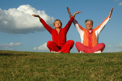 Senior women yoga outdoors Stock Photo