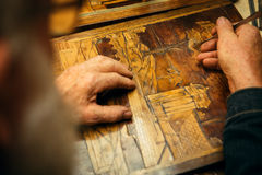 Senior wood carving professional during work Stock Photo