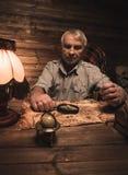 Senior in wooden interior Stock Photo