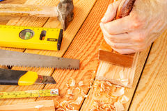 Senior woodworker or carpenter doing woodworking Stock Photos