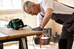Senior worker in the carpentry workshop Royalty Free Stock Photography