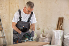 Senior worker in the carpentry workshop Stock Image
