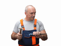 The senior worker with the chisel Stock Photography