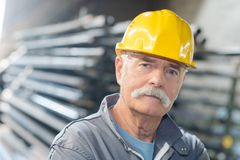 Senior worker at factory. Senior worker at the factory stock photography