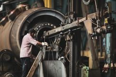 Free Senior Worker In A Dirty And Old But Still Functioning Metal Works, Old Fashioned, Factory Royalty Free Stock Images - 159478729