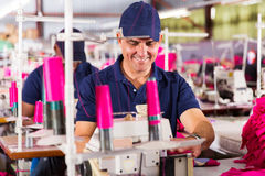 senior worker sewing Royalty Free Stock Images