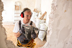 Free Senior Worker Using Drill At Contruction Site Stock Images - 93244734