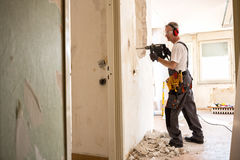 Free Senior Worker Using Drill At Contruction Site Royalty Free Stock Image - 93245026