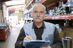 Senior worker in warehouse in factory royalty free stock photo