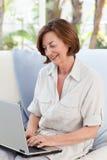 Senior working on her laptop Stock Photo
