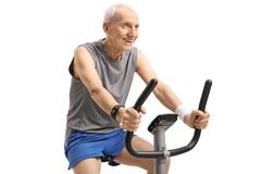 Senior working out on an exercise bike Royalty Free Stock Photos