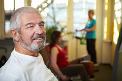 Senior working out in gym Stock Photo