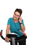 Senior working out and keeping in touch Royalty Free Stock Image